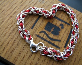 Sterling Silver accented with Red a beautiful and handmade bracelet