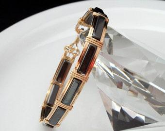 14 karat Gold filled bangle bracelet with Hematite gemstones, beautiful, elegant and handmade