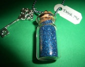 Alice in Wonderland Inspired Glass Drink Me Bottle Necklace with Blue Glitter and a Silver Metal Key Charm