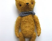 small jointed bear with striped neckerchief