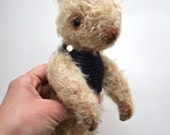 mohair rabbit with deep blue sweater