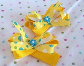 pair of hair bows- yellow, blue, green and white polka dots