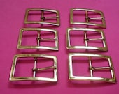 Set of Six Gold Toned Buckles