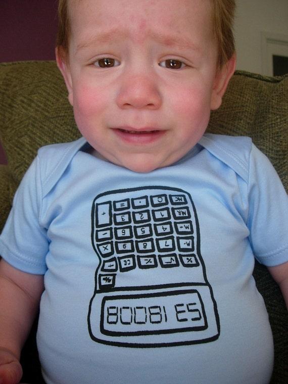 Nerd alert. Calculator onesie, upside down digits read BOOBIES.
