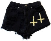 Black cutoff shorts with gold crosses