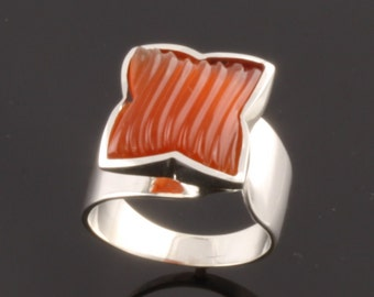 Sterling Silver Ring set with one 12mm fancy carved Carnelien