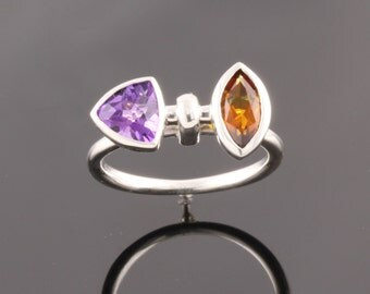 Sterling silver ring set with one 8x4mm Citrine and 6mm trillion Amethyst.