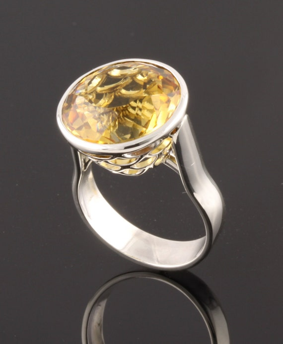 Sterling Silver Ring set with round facet cut Citrine
