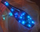 recycled bottle luminary -- repurposed blue glass with blue lights -- mesmerizing home decor