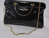 Patent Pending: Shiny Black avec Heavy Metal .goldtoned and gorgeous handles and chain .Killer purse