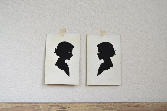Two Vintage Silhouette Pictures Girl with Glasses