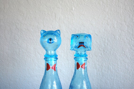 old pair of blue cat and dog wine decanters