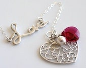 Jolie   ...matte silver love word filigree heart charm bracelet ruby Swarovski crystal. Available in other colors.