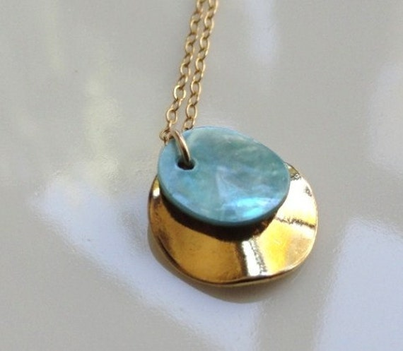 Cirie   ...gold wrinkle round disk and blue abalone shell necklace. Also available in sterling silver.