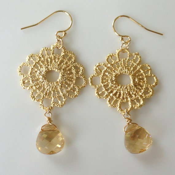 Lacey  ...matte gold lace doily pendant and golden shadow swarovski briolette earrings. Also available in other colors.