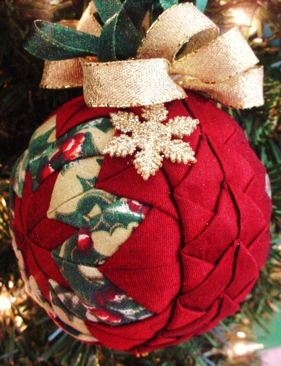 Items similar to quilted christmas ornament red braided
