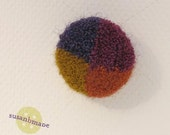 in 4ths design embroidered button in purple, orange, gold and plum