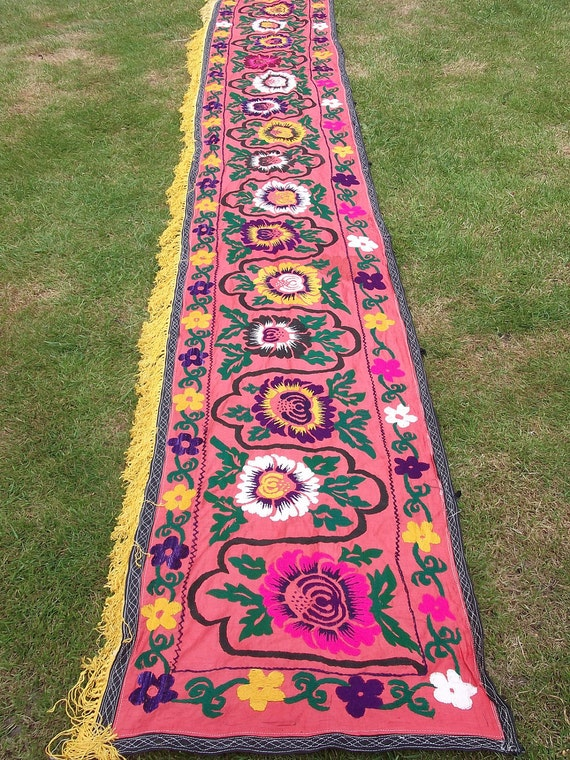 Gorgeous 12 feet long Flowery hand embroidered Zardevor Suzani from Uzbekistan. Wall hanging.
