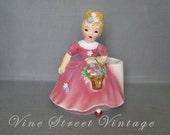 Vintage Porcelain Leftons Girl Planter Holding a Basket Full of Flowers