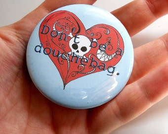 Don't be a Douchebag pin-back button with skull heart in blue and red or custom colors