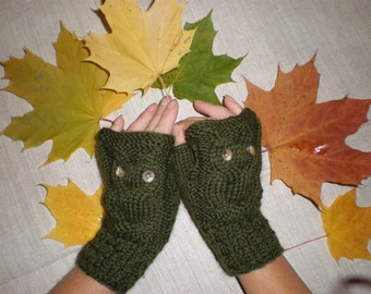 Hand-knitted green wrist warmers with knitted owl