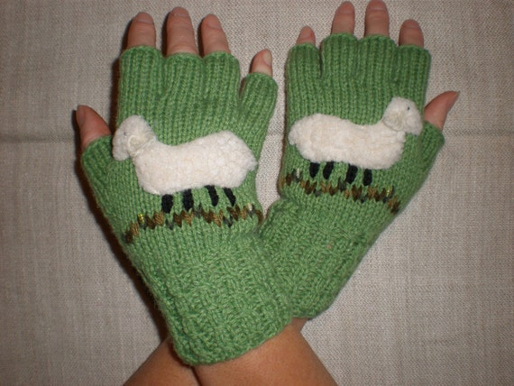 Hand-knitted green color fingerless gloves with hand needlecrafted sheep