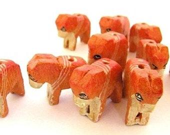 ruddy elephant bead - one (1)  wooden  elephant ruddy and shy