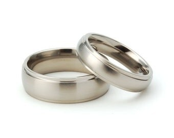 Titanium Raised Center Matching His and Hers Set- Free Sizing: 7HRRCBR.5HRRCBR