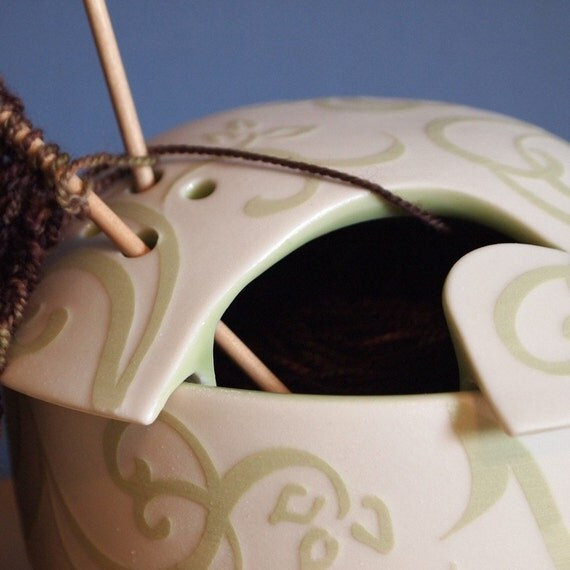 yarn bowl with embossed green swirling design