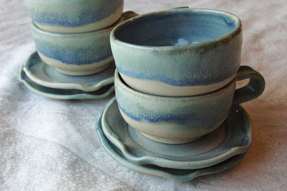 3 Blue and Cream Stoneware Tea Cups And Saucers