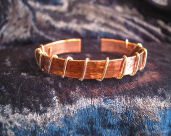 Hammered copper bracelet with sterling silver wire wrap