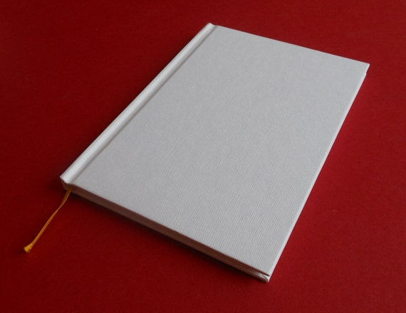 "HARDCOVER BLANK BOOK - 7 "" x 5 "" - 64 pages of 128 gsm matt paper - Begin that novel, Create that book, Everything is possible"