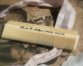 a vintage funeral director comb