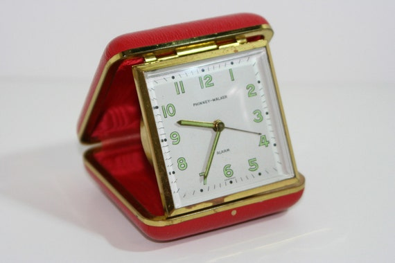 Travel alarm clock in red case