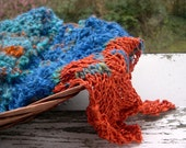 Handknitted unique art scarf in handspun yarn: 'Orange flames dancing on water'