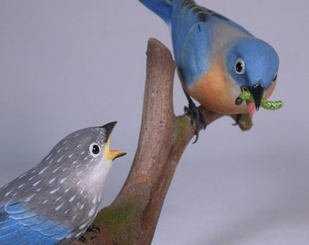 Eastern Bluebird (F) with a Baby Wooden Carved Bird