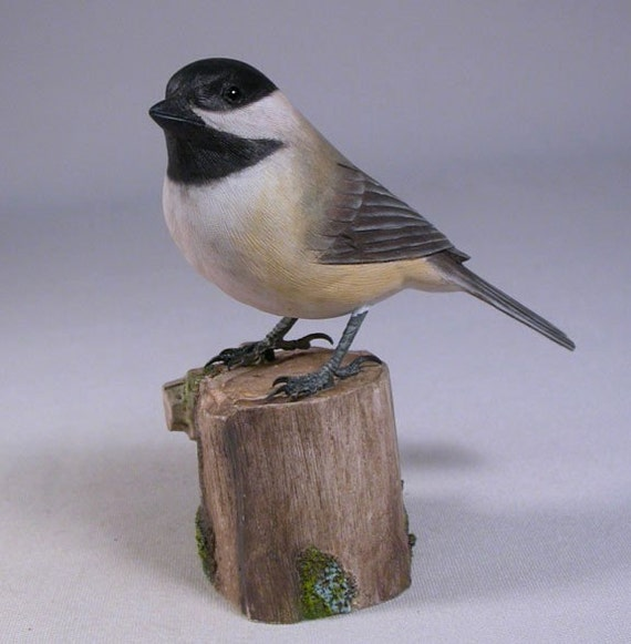Black-capped Chickadee on carved wooden base