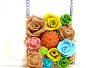 flower garden polymer clay cabochon filigree necklace with a grey chain
