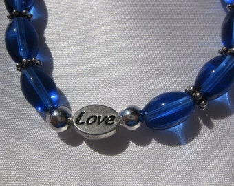 Handcrafted Bracelet Jewelry Blue Glass Beads silver plated spacers Love Heart stretchy