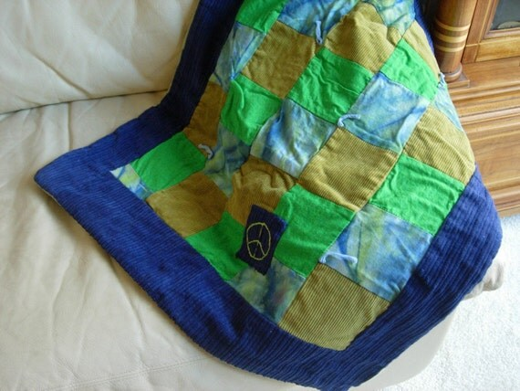 Super fun and snuggly blue and green  tie dye patchwork crib quilt