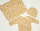 Gender neutral baby layette, blanket sweater and hat