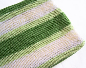 Knit baby blanket in stripes of green & cream