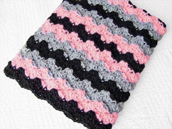 Baby blanket in crochet stripes in black, pink and grey