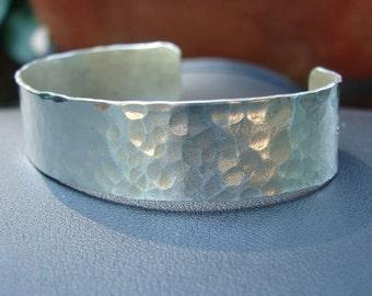 Sterling silver hammered bracelet with captivating sparkle