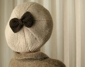 Cream Hat with Brown Bow
