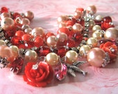 Red Robin Red Robin - A Layered Assemblage Bracelet Done Up In LuSciOuS Reds  Heart-Pounding PiNkS  Sassy PeAcHeS  And PaSsiOnAtE Corals - With Roses And Rhinestones And Pearls And Birds - A Charm Bracelet Of Gorgeous Proportions And Shimmering Colors