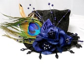 Black mini top hat fascinator  with royal peacock feathers and flowers