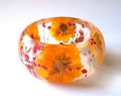 Size Medium Red and Yellow Botanical Resin Bangle.   Real Flowers - Red Baby's Breath and Yellow Cosmos.  Custom Engraving.