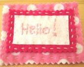 Fabulously girlie Hello pin/badge