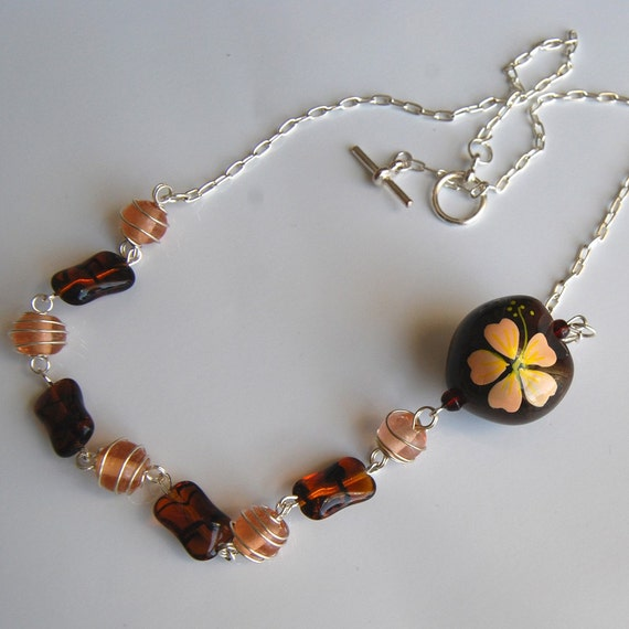 brown kukui nut hibiscus flower necklace by solemardesigns